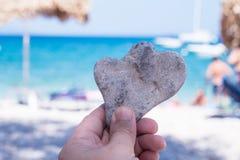Heart shaped stone on the beach. Royalty Free Stock Photos