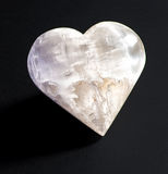 Heart shaped stone on a black background Royalty Free Stock Images