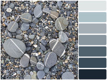 Heart shaped stone with color palettes. Color palette series: shades of gray stock images
