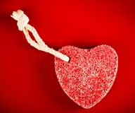 Heart-shaped stone with rope Stock Images