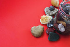 Heart shaped stone, shell and  sea pebble Royalty Free Stock Images