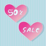 Heart shaped store sale stickers. Pink store sale stickers on bleu striped background Royalty Free Stock Photography