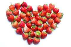 Heart shaped strawberries. On isolated background Royalty Free Stock Images