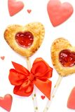 Heart shaped strawberry pie pops, red glazed cookies and candy. stock photo
