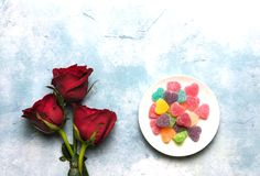 Heart-shaped sugar coated jelly with roses royalty free stock photography