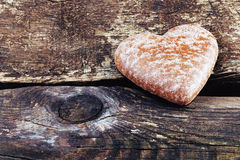 Heart shaped sugar cookie on old wooden background Royalty Free Stock Images