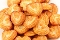 Heart shaped sugar sprinkled biscuits. Closeup of heart shaped sugar sprinkled biscuits Royalty Free Stock Image