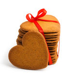 Heart shaped sugarcookie tied with red ribbon Royalty Free Stock Photos