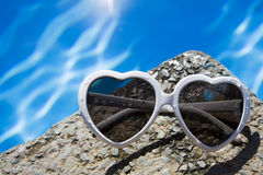 Heart Shaped Sunglasses by Pool Royalty Free Stock Image