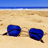 Heart-shaped sunglasses in the sand of a beach Stock Photography