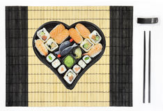 Heart shaped sushi plate on tablemat Stock Images