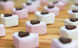 Heart shaped sweets on a wooden kitchen worktop. Close up. stock image