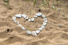 Heart shaped symbol made of small stones Royalty Free Stock Photography