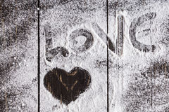 Heart shaped symbol with  powdered sugar Stock Images