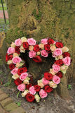 Heart shaped sympathy flowers Stock Photo
