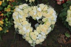 Heart shaped sympathy wreath near a tree Stock Photos