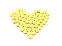 Heart-shaped tablets. Arranged in a heart-shaped tablets Stock Photography