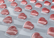 Heart shaped tablets, pills in transparent, reflecting blister pack Stock Photography