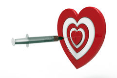 Heart shaped target and syringe, 3d rendering Royalty Free Stock Photos