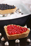 Heart-shaped tart with redcurrant Royalty Free Stock Images