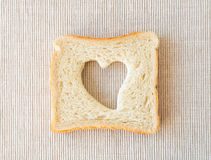 Heart shaped toast. On a tablecloth background Royalty Free Stock Photo
