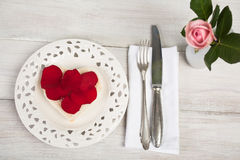 Heart shaped toast with rose petals and single rose in a vase Stock Photos