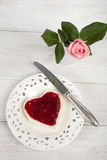 Heart shaped toast with strawberry jam and single rose in a vase Royalty Free Stock Photography