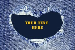 Heart shaped torn jeans texture with space for text royalty free stock image