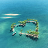 Heart-shaped tropische Insel Lizenzfreies Stockfoto