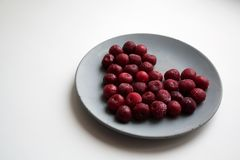 Heart shaped valentine composition of frozen cherries stock photography