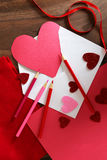 Heart Shaped Valentine`s Day Card in Envelope on Table with Art Royalty Free Stock Image