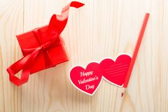 Heart-shaped Valentine day greeting card and red present box stock photos