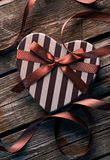 Heart shaped Valentines Day box with curved ribbon Stock Photography