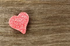 Heart shaped Valentines Day candy on wood Stock Images