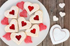 Heart shaped Valentines Day cookies and candies, overhead scene on wood Royalty Free Stock Images
