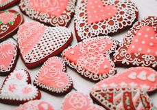 Heart shaped Valentines Day cookies with sugar decorating royalty free stock images
