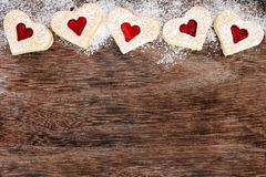 Heart Shaped Valentines Day Cookies Top Border Over Rustic Wood Royalty Free Stock Photography