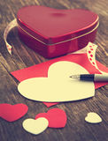 Heart shaped Valentines Day gift box and empty greeting card. On wooden background Royalty Free Stock Photos