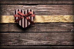 Heart shaped Valentines Day gift box with ribbon Royalty Free Stock Photos