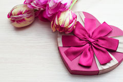 Heart shaped Valentines Day gift box with tulips and place for text Royalty Free Stock Photo