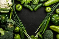 Heart shaped vegetables. Food photography of heart made from different vegetables on black background royalty free stock photo