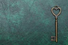 Heart shaped vintage key Stock Images