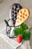 Heart-shaped waffle with chocolate Royalty Free Stock Photography