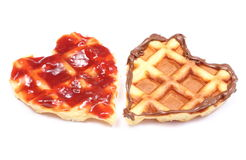 Heart shaped waffles with chocolate cream and strawberry jam Royalty Free Stock Photos