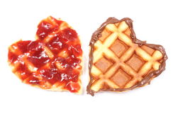 Heart shaped waffles with chocolate cream and strawberry jam Stock Photo