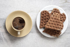 Heart shaped waffles and coffee on table Royalty Free Stock Image