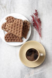 Heart shaped waffles and coffee on table Stock Image