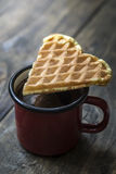 Heart shaped waffles and coffee on table Stock Photo