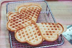 Heart shaped waffles on wooden table background stock image
