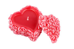 Heart-shaped wax candle with roses Stock Photo